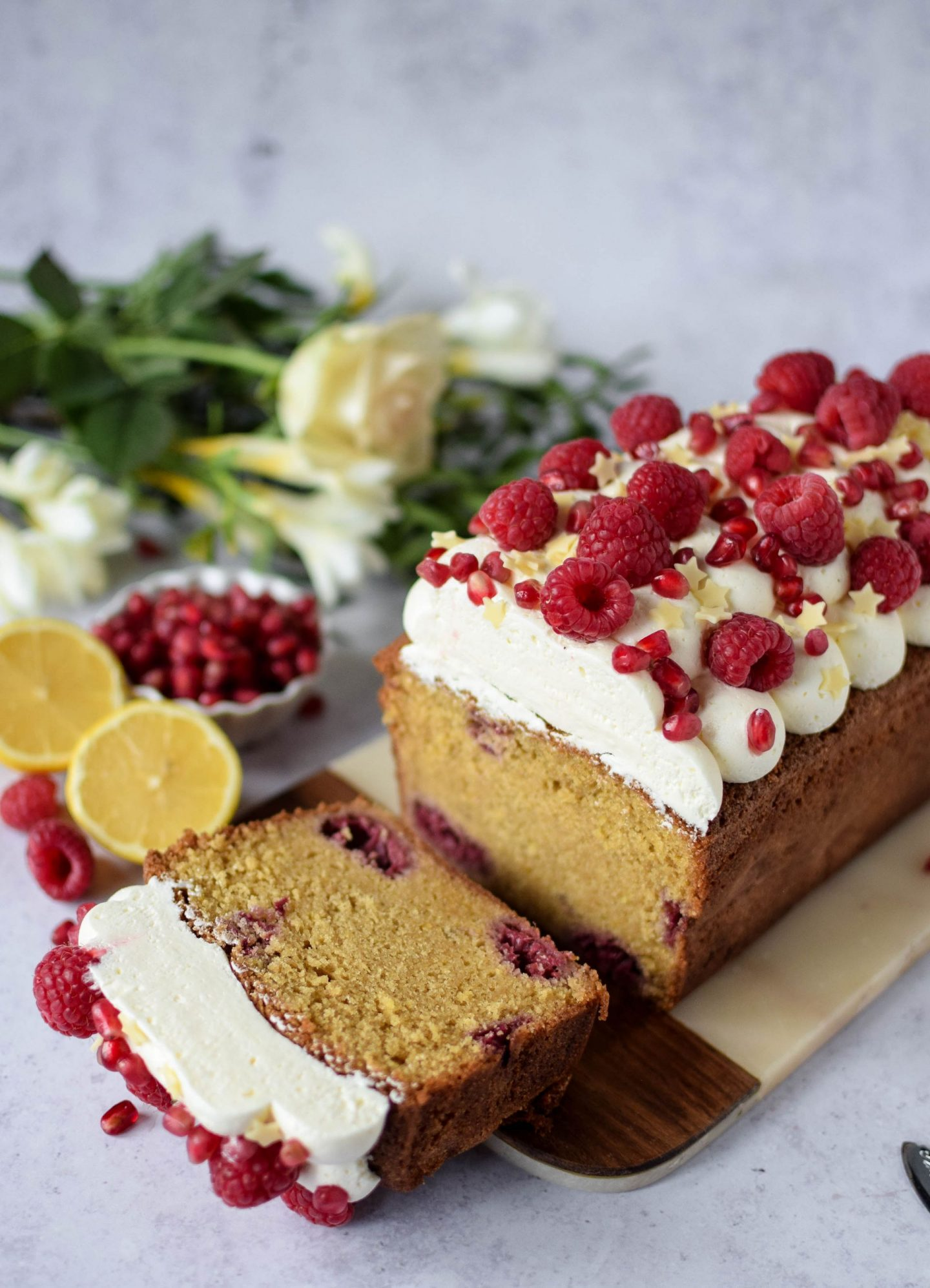 lemon and raspberry cake with one slice removed.