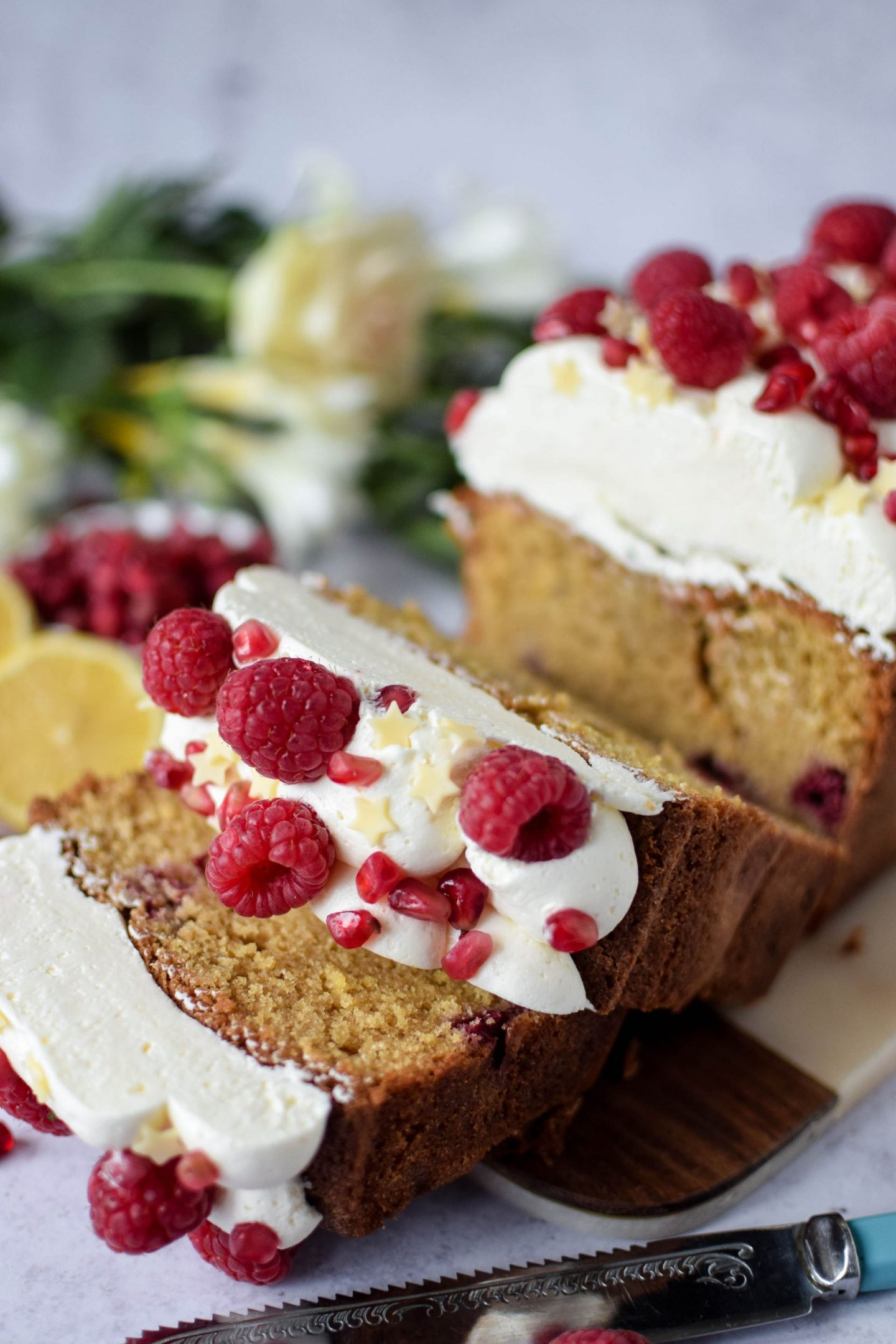 close up of a slice of lemon and raspberry cake