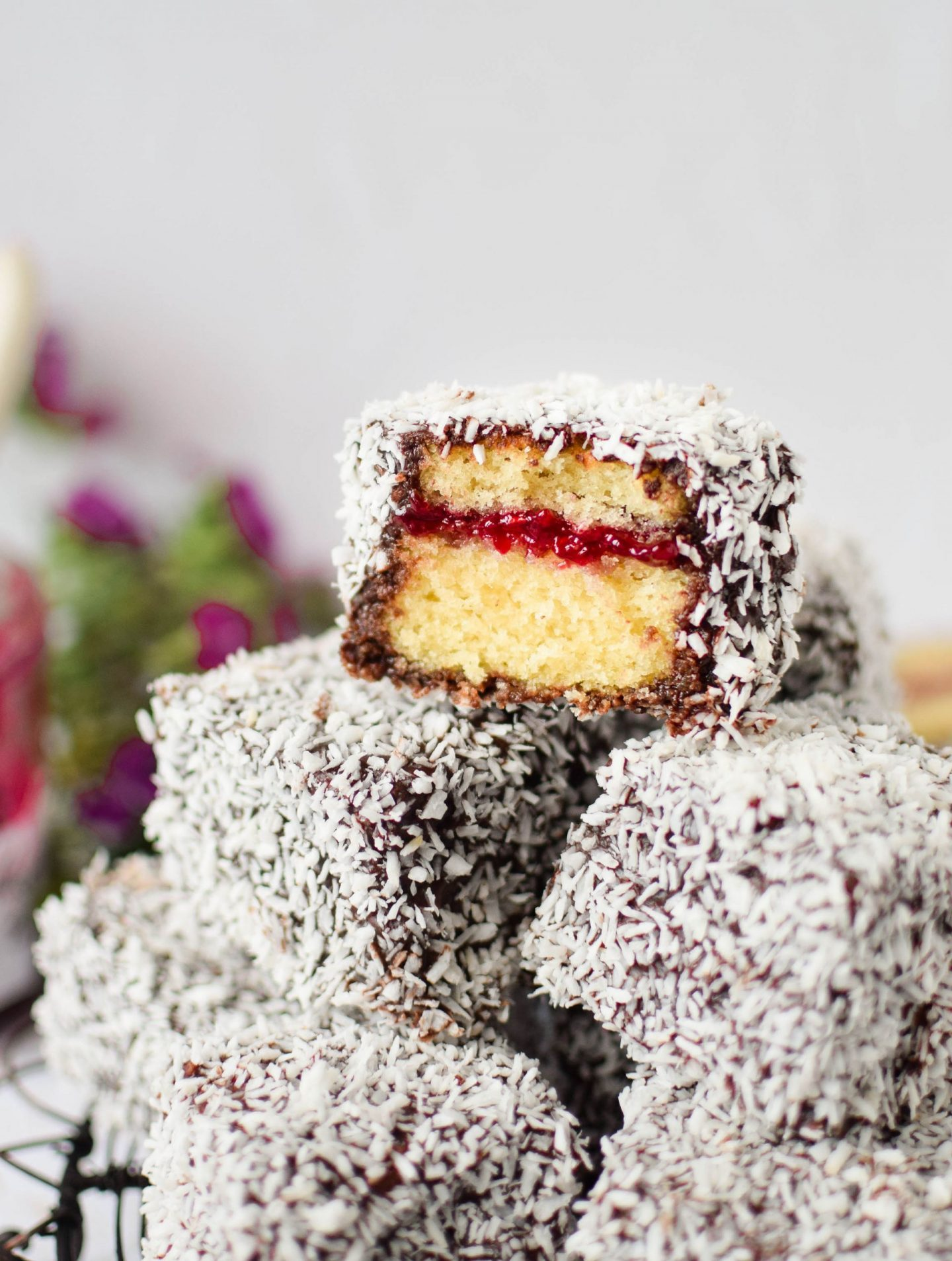 Close up of a cross section of a homemade lamington cake.