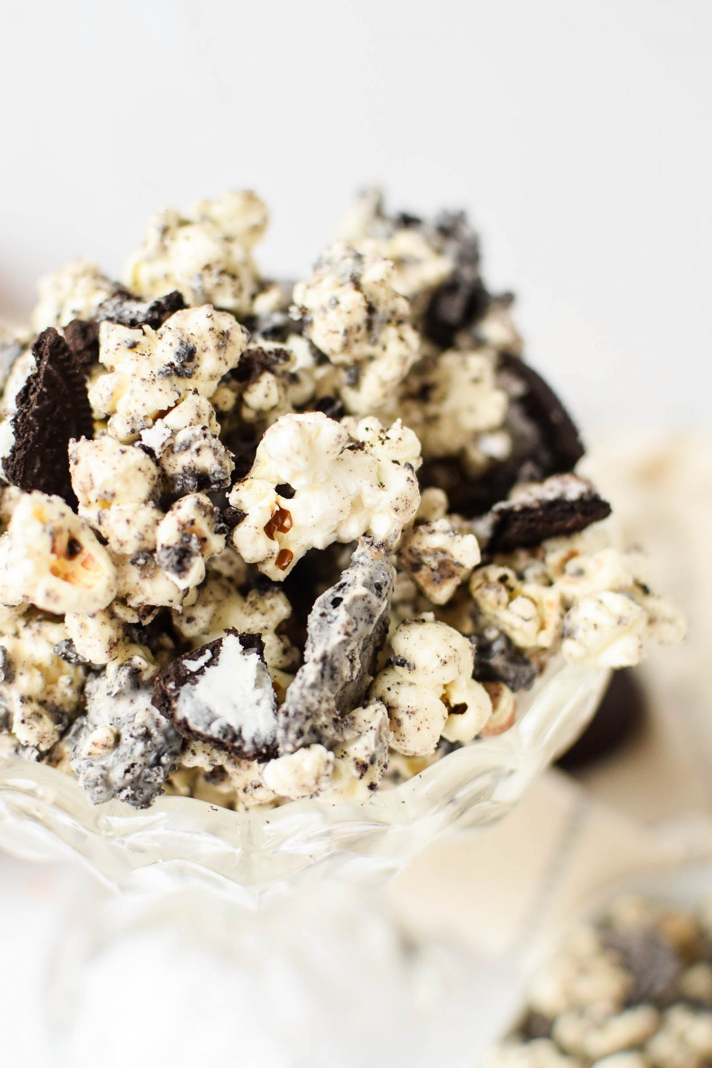 Close up shot of Oreo Popcorn in a glass bowl.