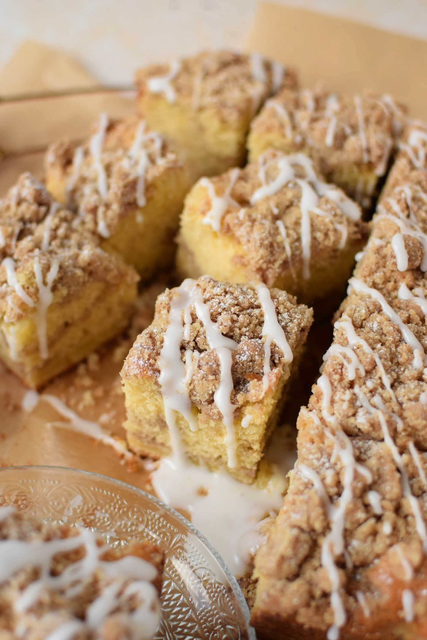 New York Crumb Cake with a vanilla frosting drizzled on the top.